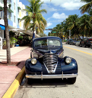 Photo of an antique oldsmobile in Miami Beach, Florida