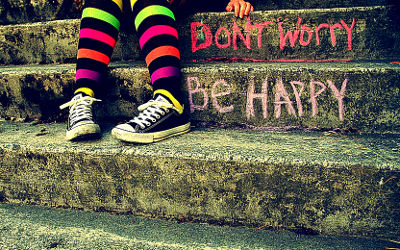 Photo of don't worry, be happy street art.