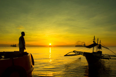 Photo of a boat at sunrise in the Philippines